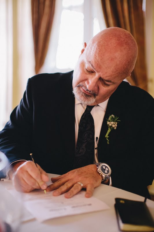 Ray Waters signing a marriage license